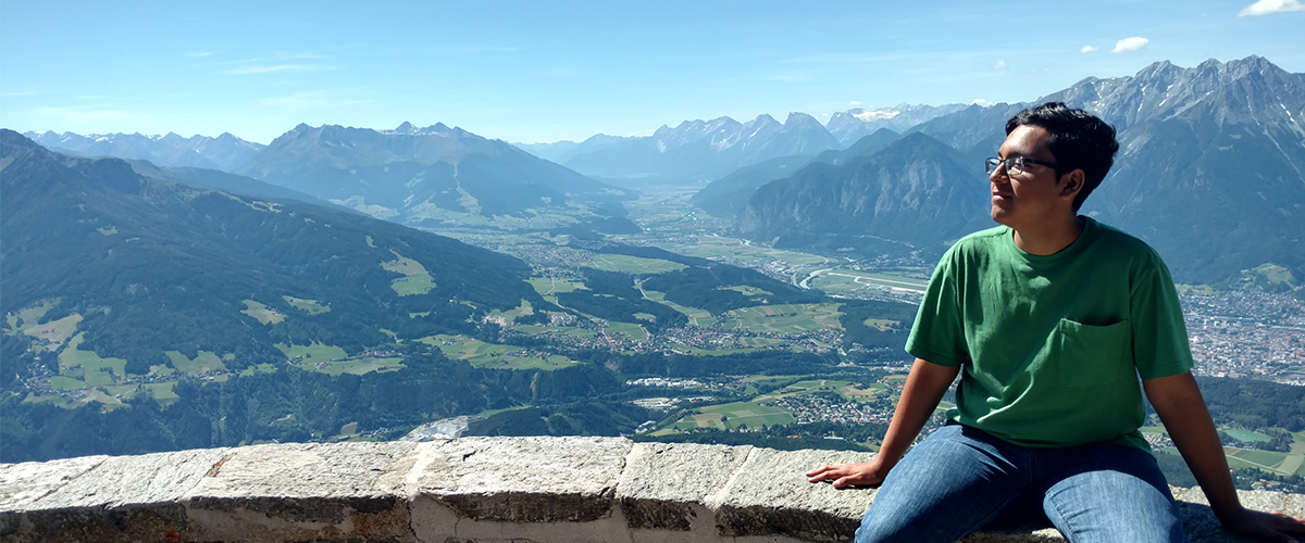Anthony Carreon smiling in Austrian lanscape