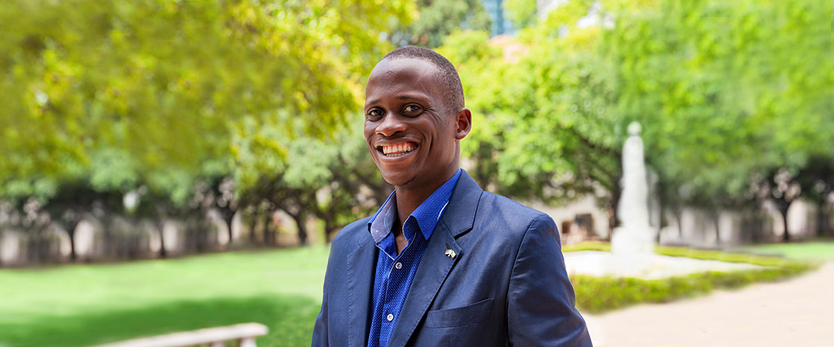 Augustino Agbemavo poses in the UT campus