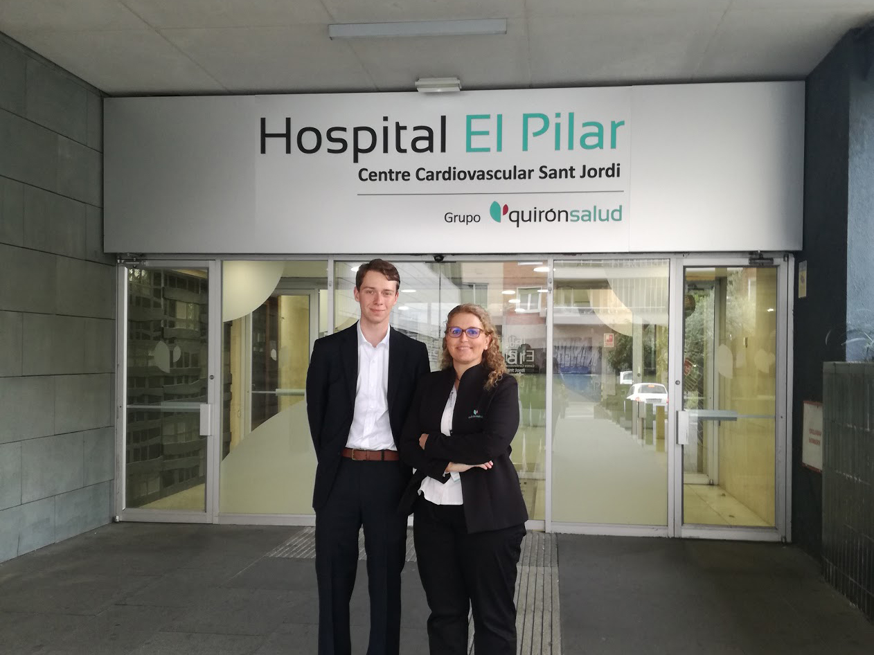 Cameron in front of the hospital he interned in, Hospital El Pilar