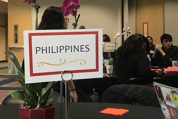 Country discussion table sign saying Philippines