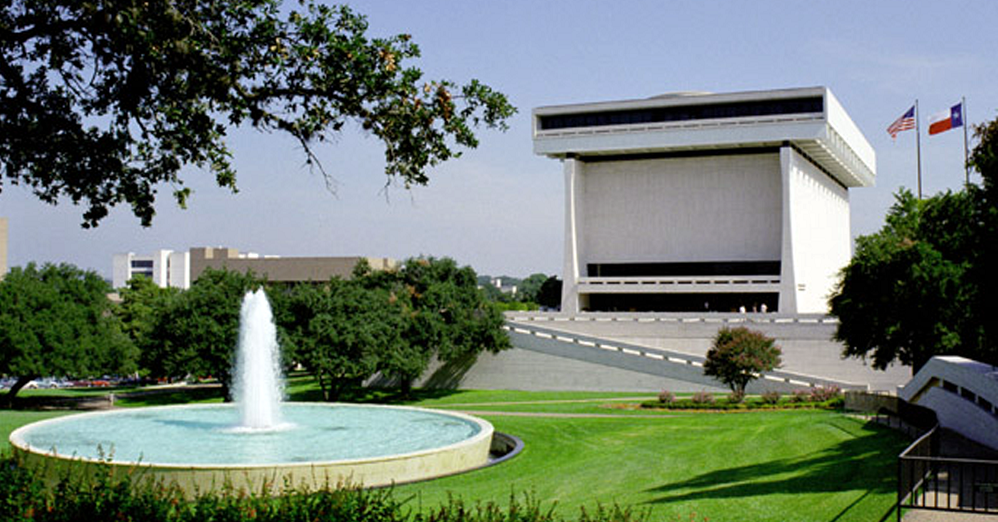 A view of the LBJ Library and fountain.