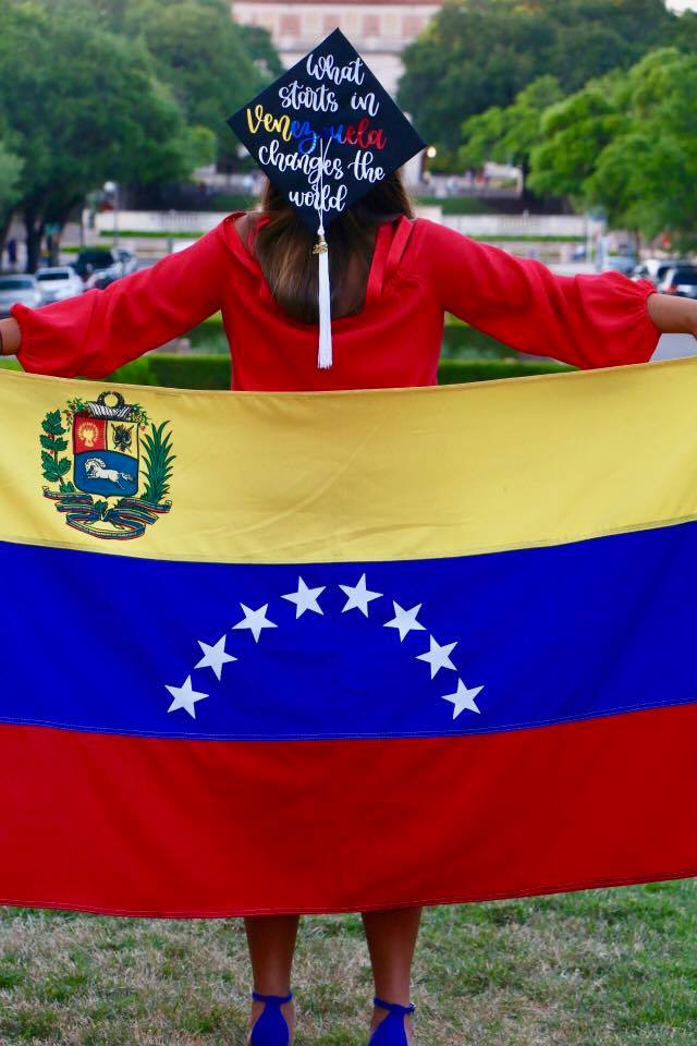 Marielisa in her cap and gown with a Venezuelan flag