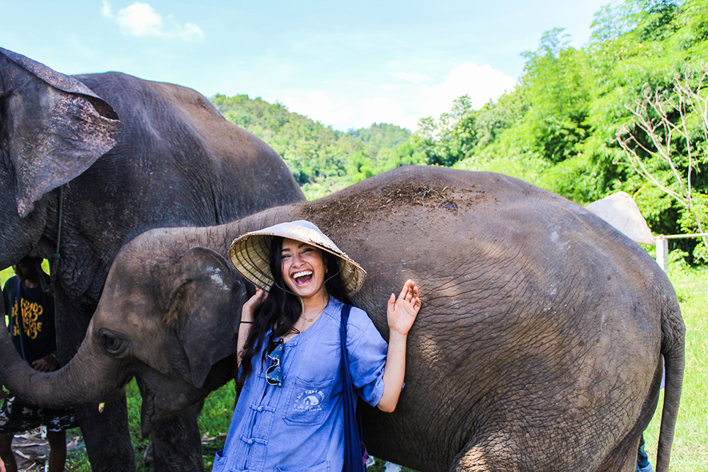 Student with an elephant in Thailand