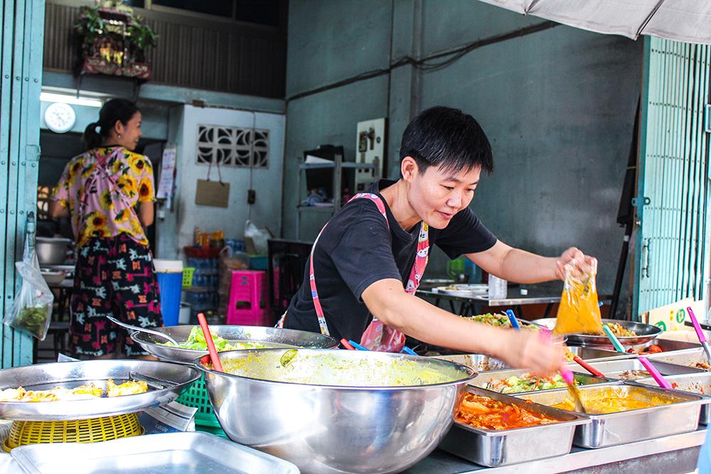 A woman selling food in Bangkok