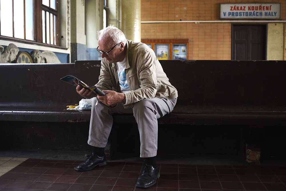 A man reading a magazine in Prague