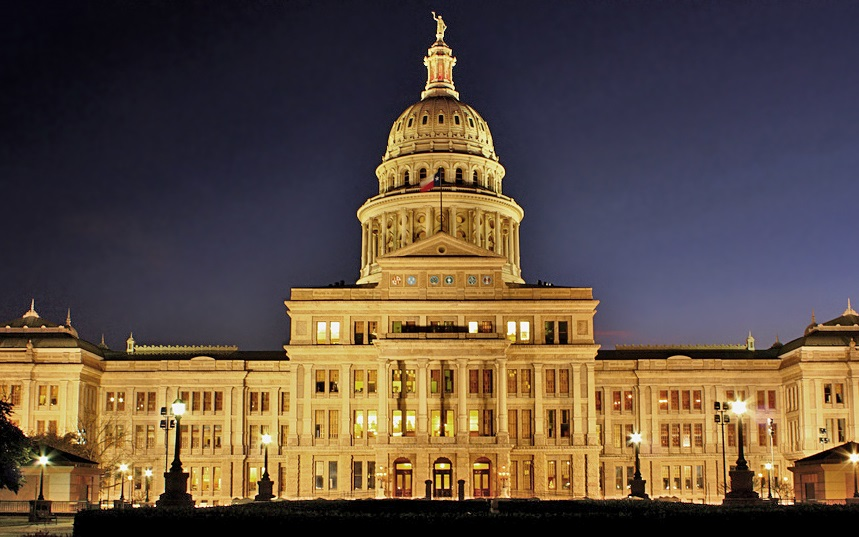 A view of the Texas State capitol at night.