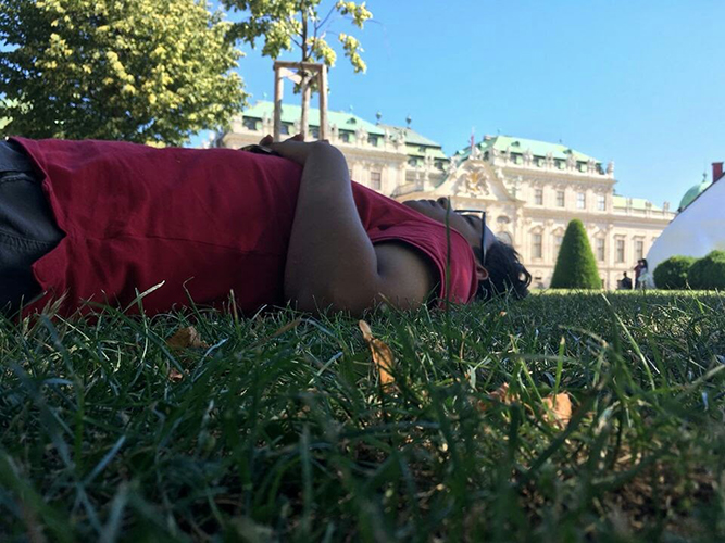 Anthony lying on the ground in Austria