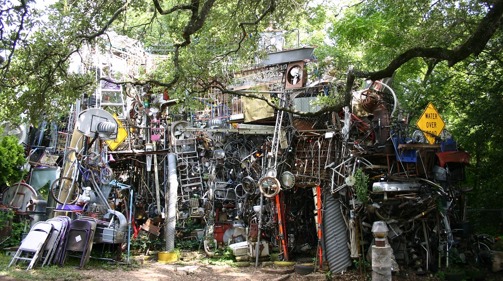 A view of the Cathedral of Junk with various objects arranged into a structure.