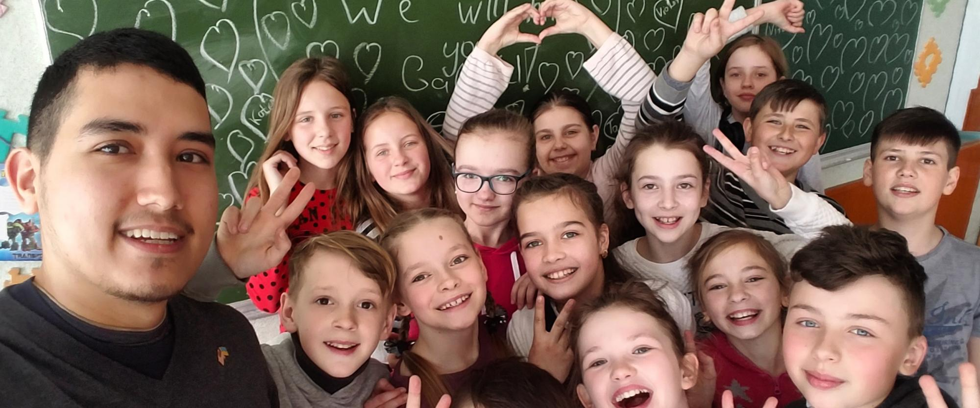 gabriel stands with his 5th grade class in Ukraine