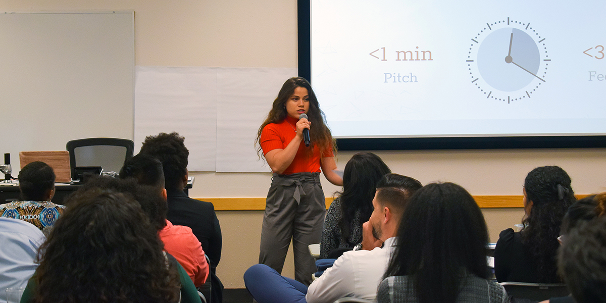 An alumna presents her elevator pitch for a startup idea.