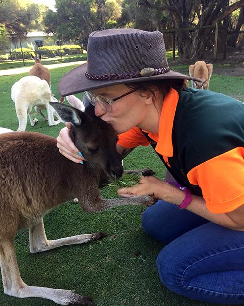 ally gunderson holds a kangaroo during her internship in australia