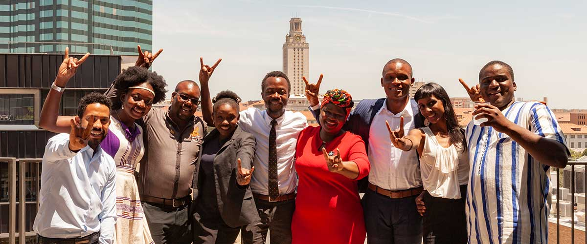 Pillay with a group of Fellows with a view of the UT Tower.