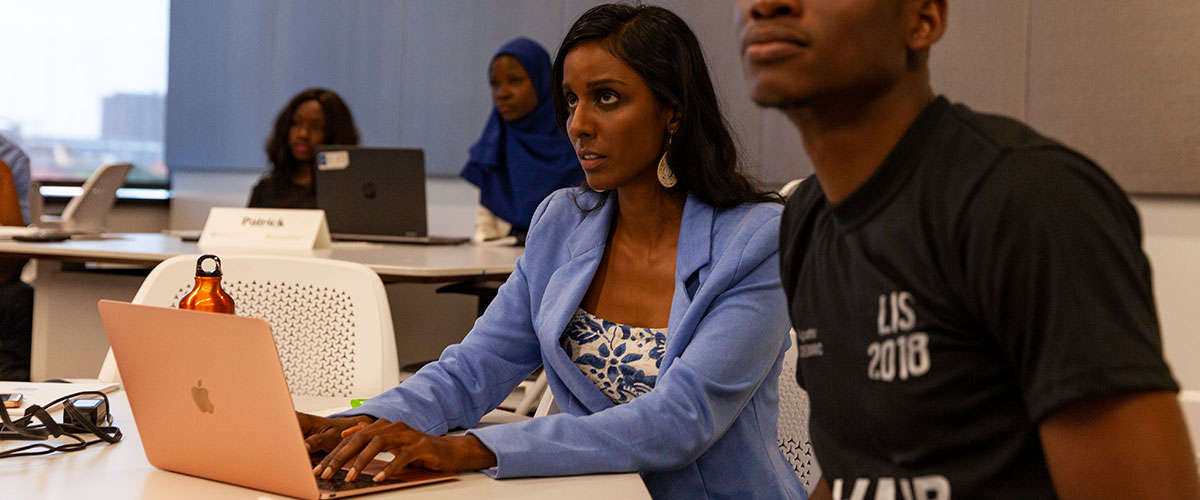 Verashni Pillay takes notes on her laptop during class.