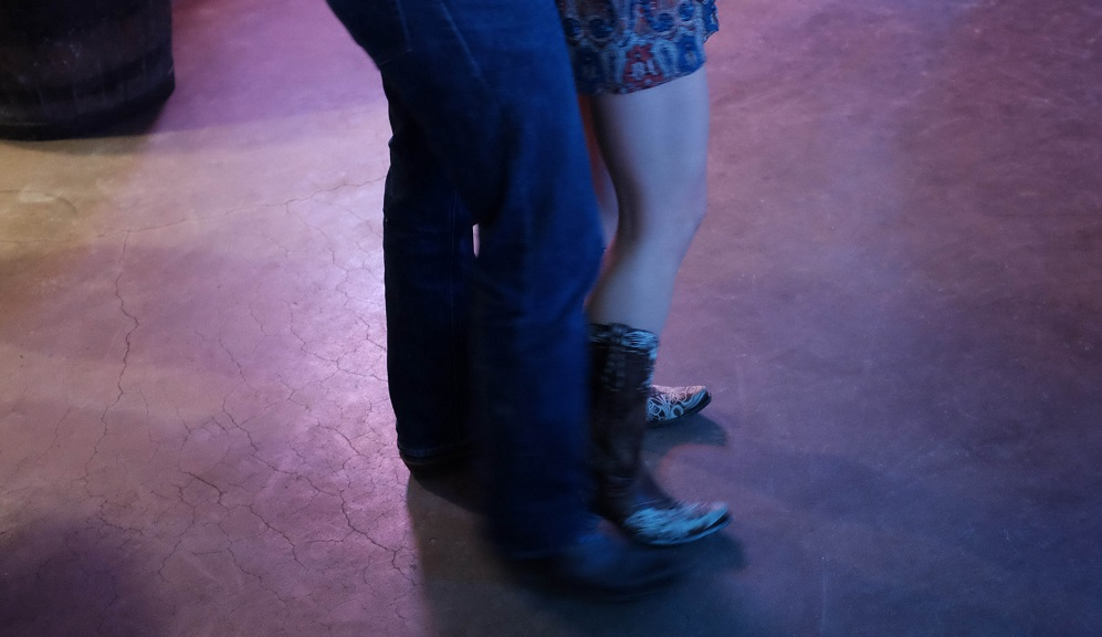 Two people dancing at the Broken Spoke.