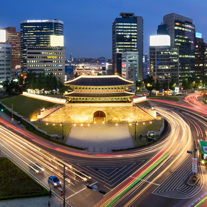Busy city streets of Seoul, South Korea, at night.