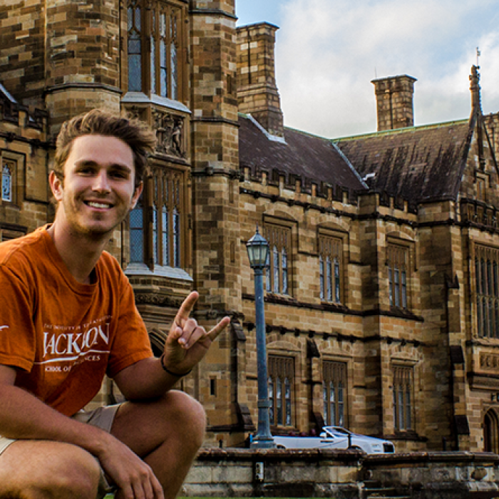 UT Austin student in Europe with the Hook'em Horns handsign.
