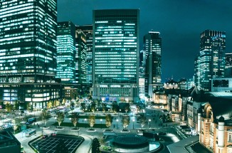 a view of buildings in tokyo at night