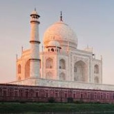Taj Mahal at sunset with green lawn