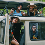 Students abroad in safari hats and van.