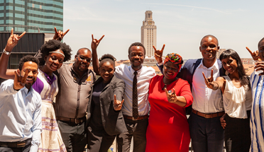 6th cohort of the Mandela Washington Fellowship pose for a photo with skyline behind them