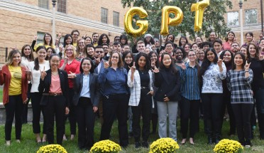 participants in GPT asia 2019 hold up a hook em and pose on campus