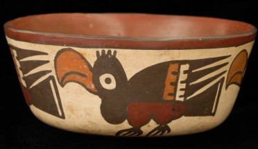 a peruvian artifact with a bird painted on it