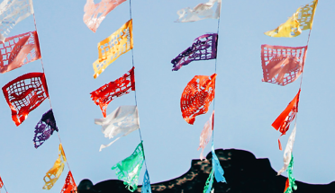 colorful flags hanging in the sky in latin america