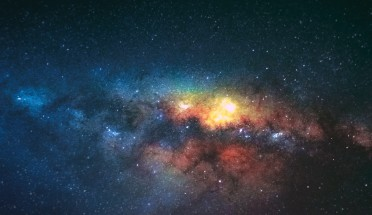 colourful galaxy in dark sky with stars