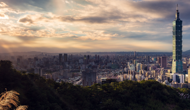 a view of the taipei cityscape at sunset